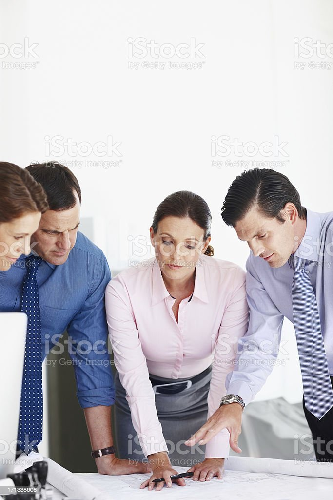 Going over the plans with a fine toothed comb royalty-free stock photo