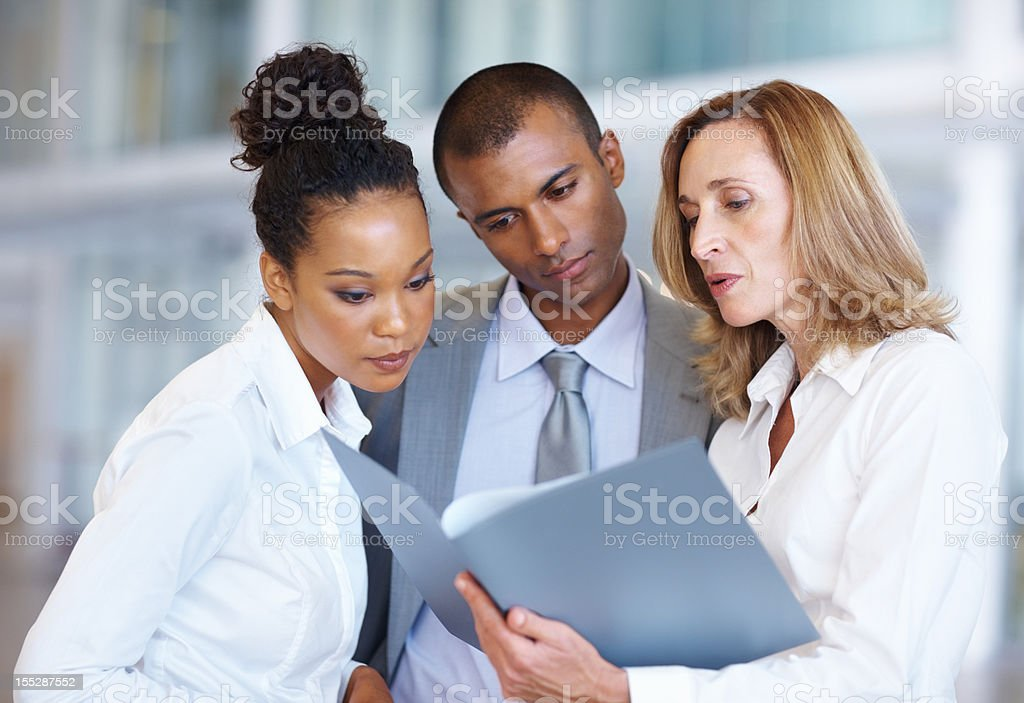 Going over their documents royalty-free stock photo