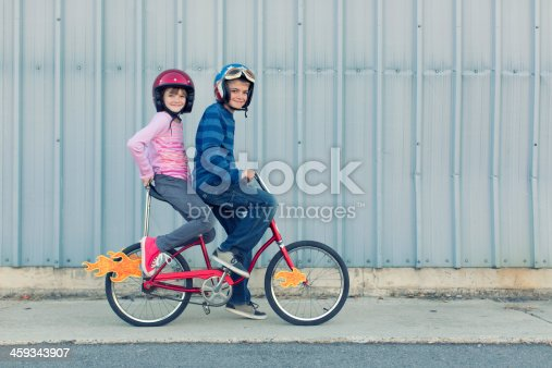 A brother and sister team up to go super fast on a bike. Where are you going and how are you getting there?