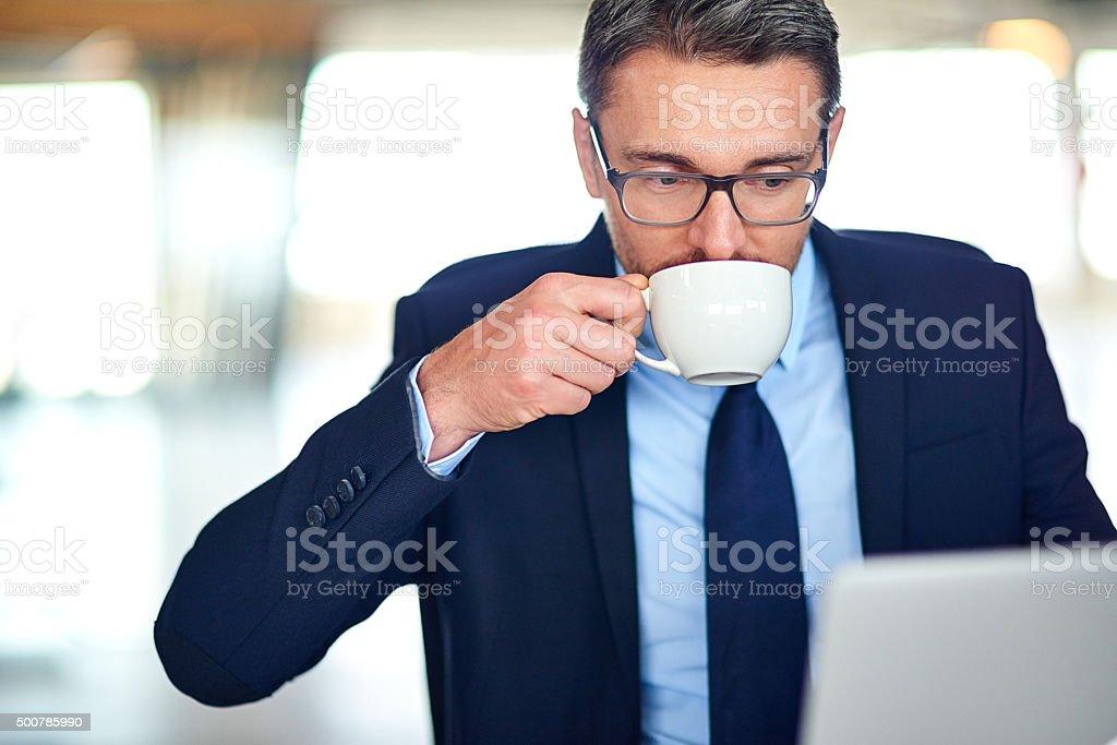 Going through his inbox stock photo