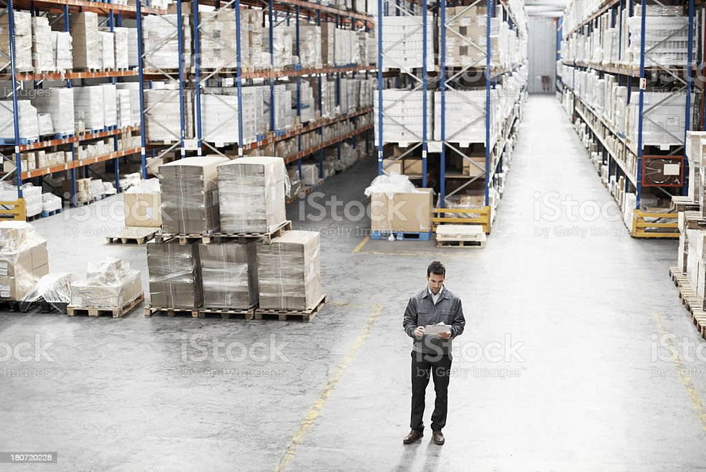 Going through his inventory list royalty-free stock photo