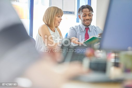 istock Going through job role 874298190