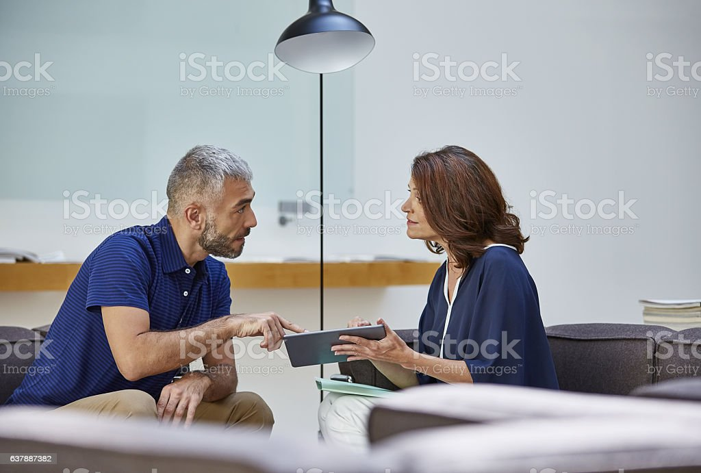 Going through the company's data together stock photo