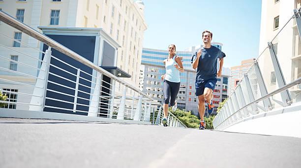 going to beat you! - jogging hill bildbanksfoton och bilder