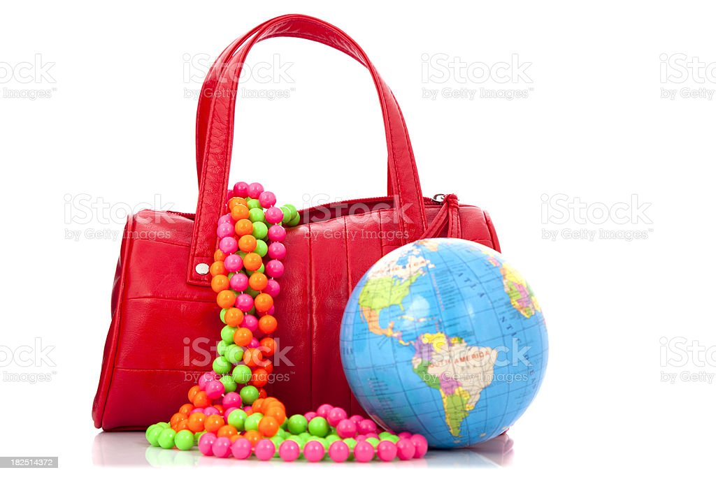 Going to Mardi Gras - Red bag and world royalty-free stock photo