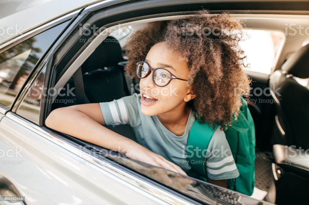 Going to school on family car stock photo