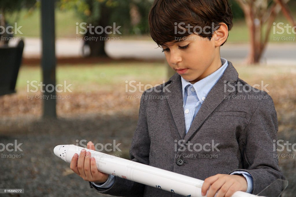 Going to space a boy with space rocket with suits stock photo