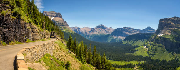going to the sun road with panoramic view of glacier national park - us glacier national park stock pictures, royalty-free photos & images