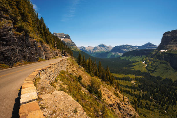 going to the sun road with panoramic view of glacier national park - going to the sun road stock pictures, royalty-free photos & images