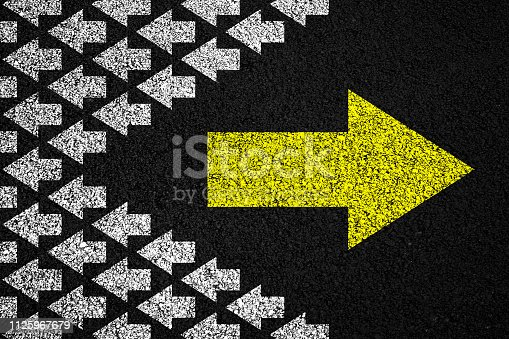 621936988 istock photo Going your own way on asphalt background 1125967679