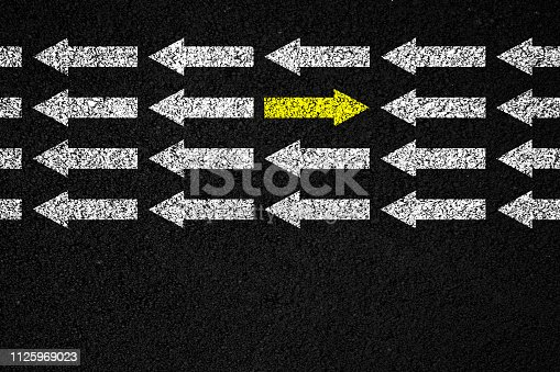 621936988 istock photo Going your own way on asphalt background 1125969023