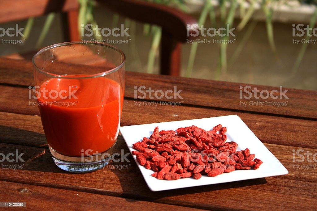 goji berries and juice stock photo
