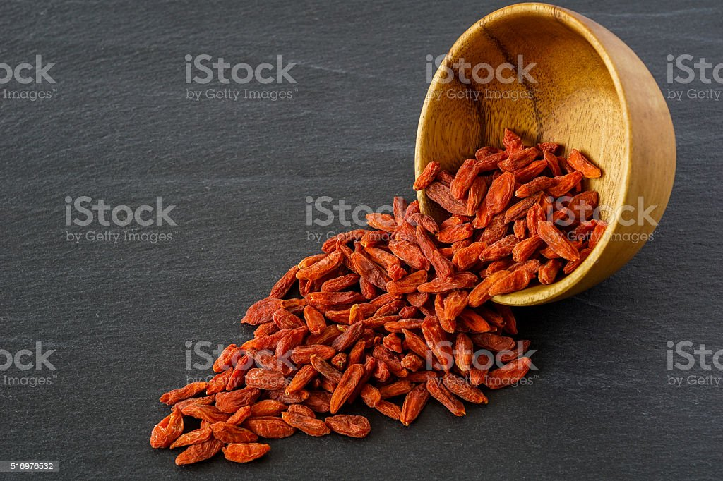 Goji Berries in a Wooden Bowl stock photo