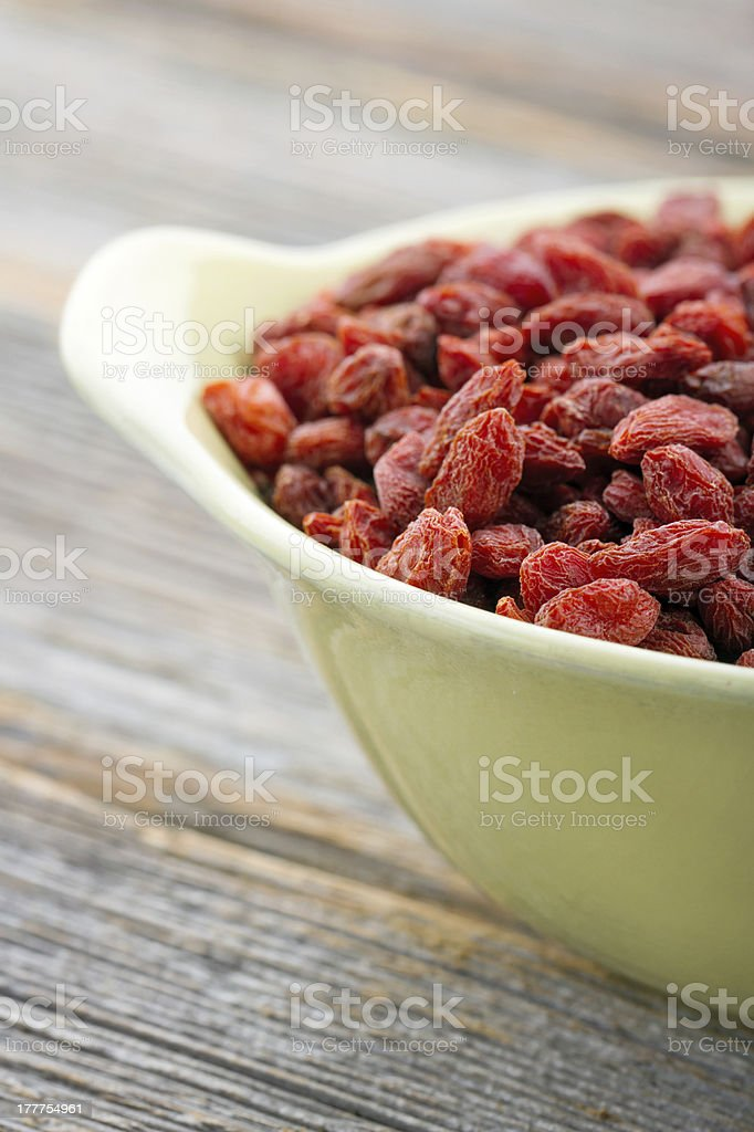 Goji berries in a yellow bowl royalty-free stock photo