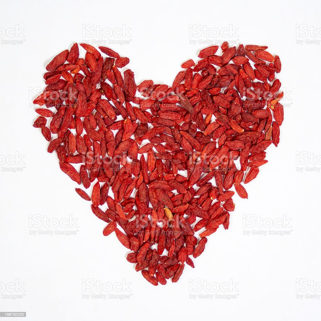 Goji berries in heart shape royalty-free stock photo