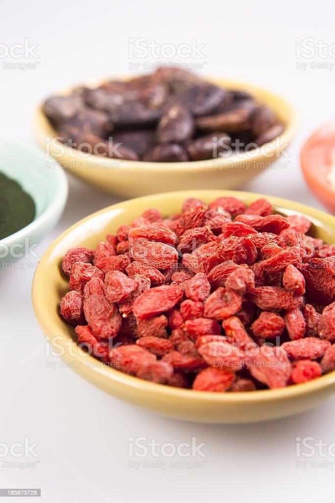 Goji berries, Maca, Spirulina, Cacao royalty-free stock photo