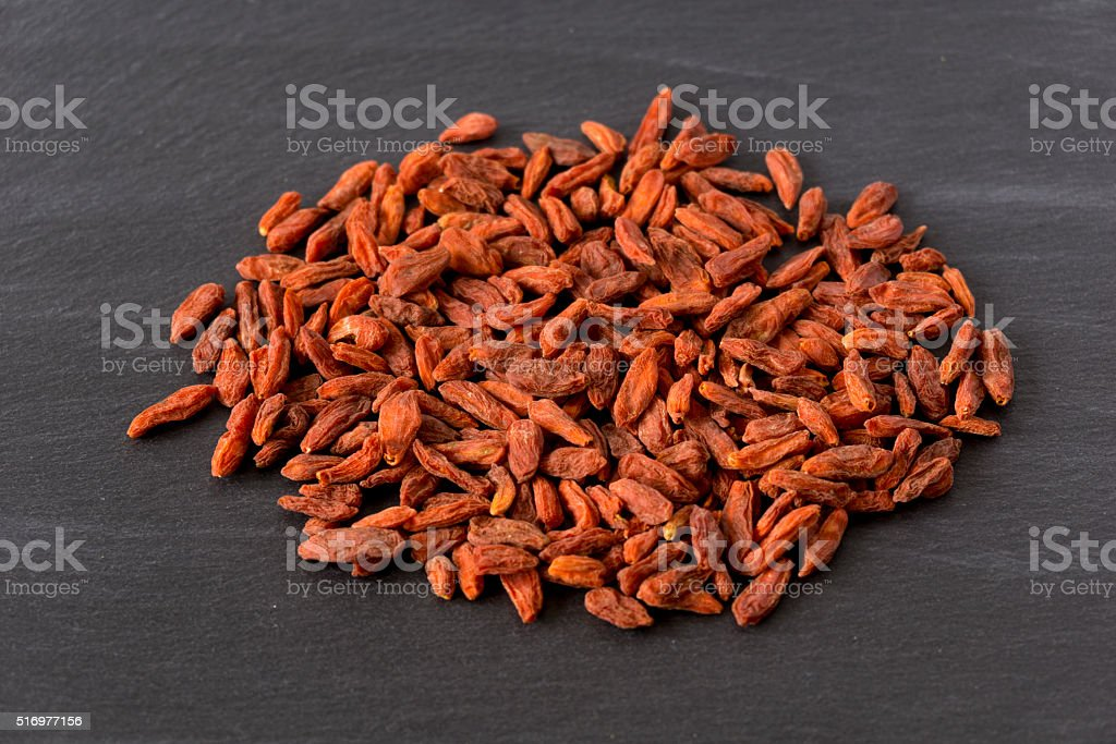 Goji Berries on a stone plate stock photo