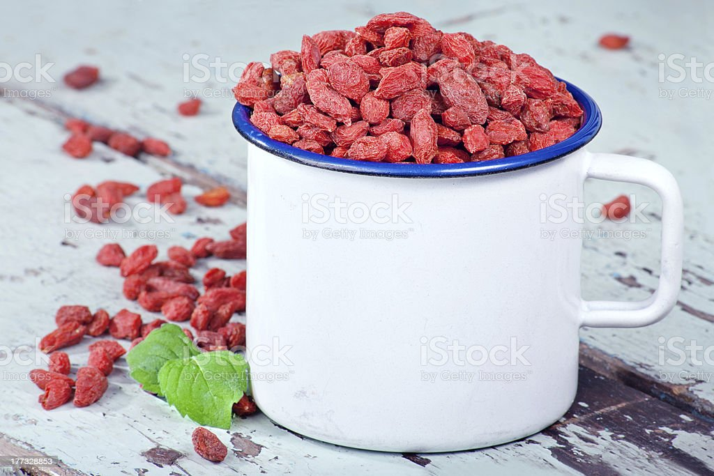 Goji berries on a wooden background royalty-free stock photo