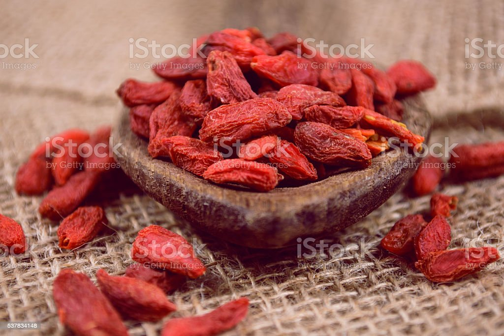 Goji berries on wooden table stock photo