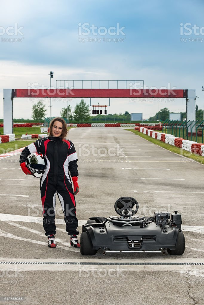 Go-karting girl posing on the track stock photo