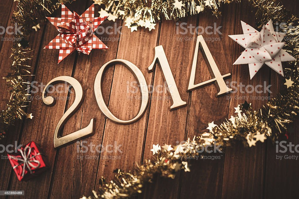 Gold 2014 New year text on christmas decoration
