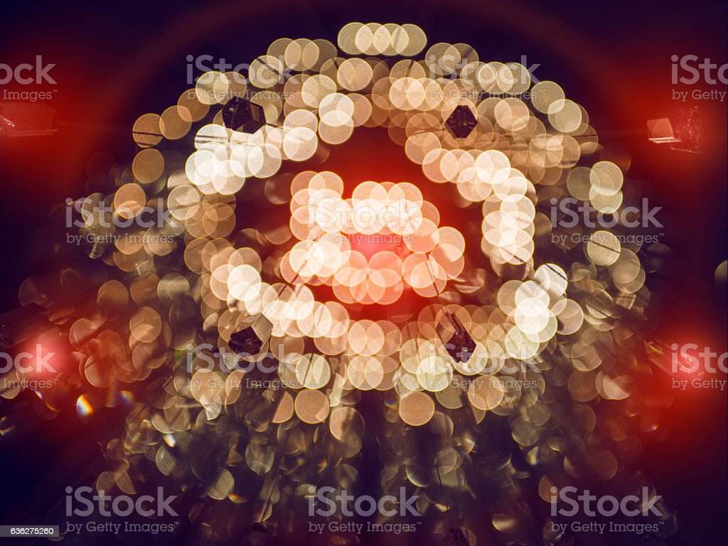 gold abstract background with bokeh defocused lights and red flashes - foto de acervo