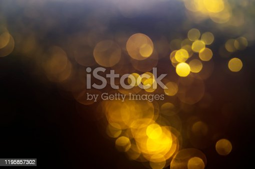 846933050 istock photo Gold abstract bokeh on black background 1195857302