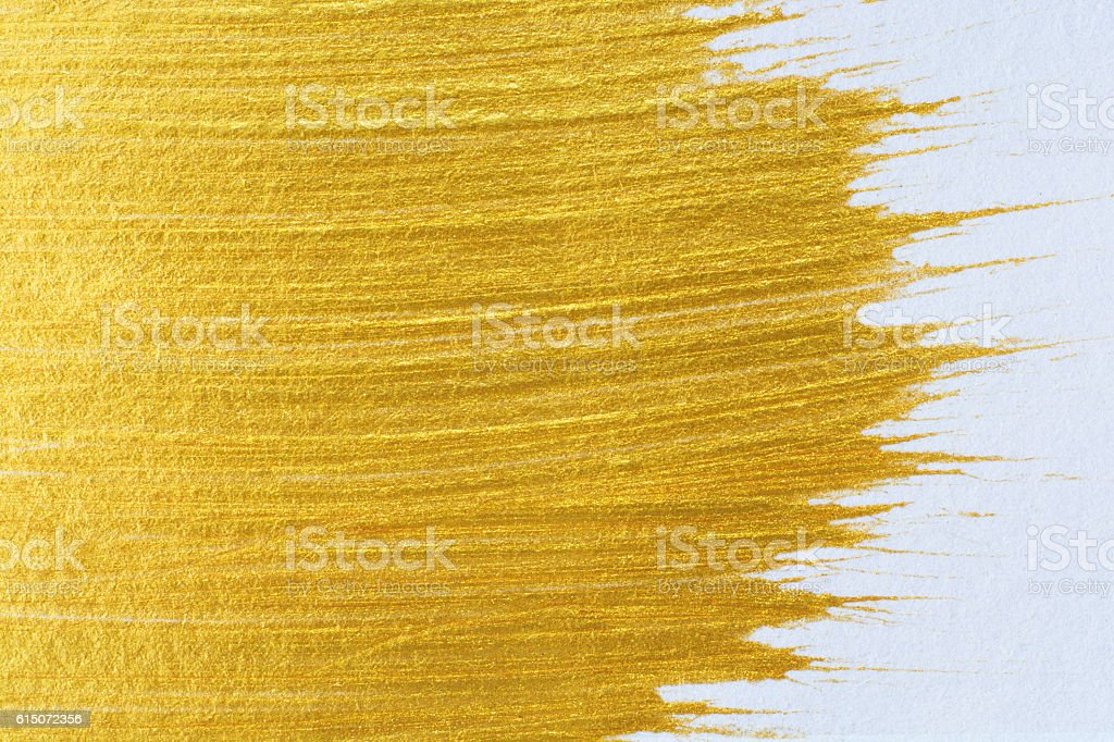 Gold acrylic paint on white paper background , gold texture free - Photo