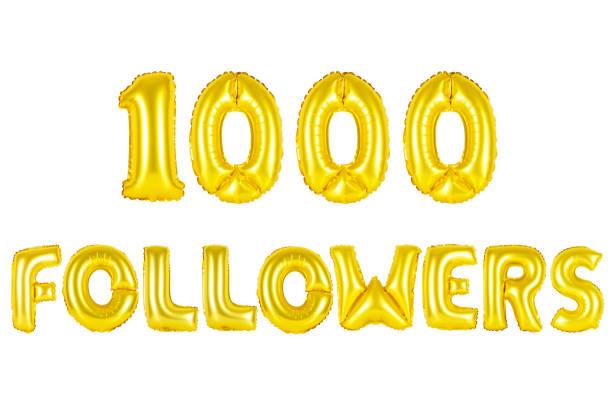 Gold alphabet balloons, 1000 (one thousand) followers stock photo