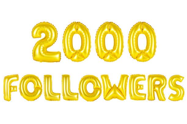 Gold alphabet balloons, 2000 (two thousand) followers stock photo
