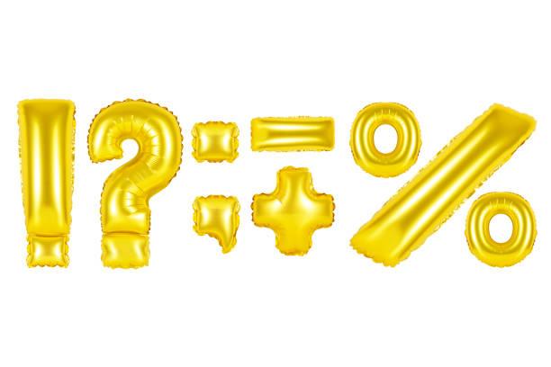 Gold alphabet balloons, punctuation marks stock photo