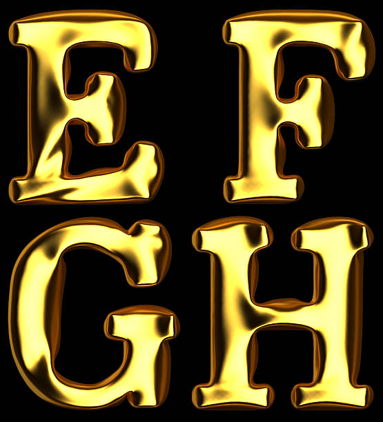 Gold alphabet on black background.  Added clipping path stock photo