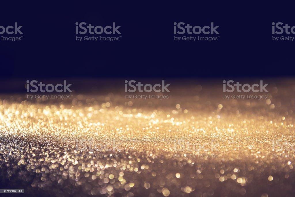 Gold und schwarz Glitzer Lichter Bokeh abstrakten Hintergrund Urlaub. unscharf gestellt. – Foto