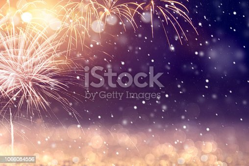 969086552istockphoto Gold and blue Fireworks and bokeh in New Year. Abstract background winter holiday. 1066084556