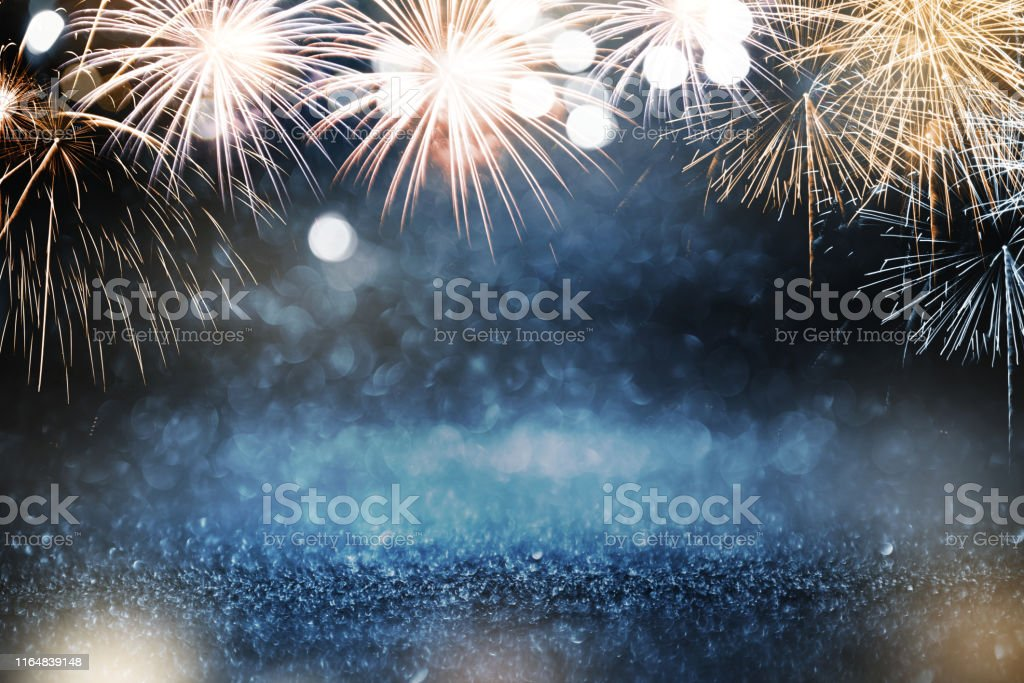 Gold and blue Fireworks and bokeh in New Year eve and copy space. Abstract background holiday. - Royalty-free 2020 Foto de stock