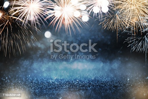 Gold and blue Fireworks and bokeh in New Year eve and copy space. Abstract background holiday.
