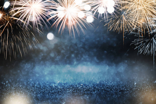 gold and blue fireworks and bokeh in new year eve and copy space. abstract background holiday. - fireworks stock pictures, royalty-free photos & images