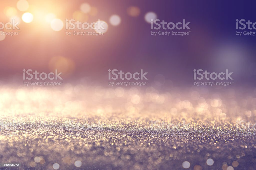 Gold and blue glitter lights bokeh abstract background holiday. defocused.