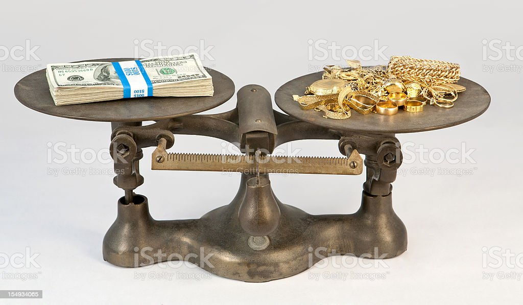 gold and cash scale royalty-free stock photo