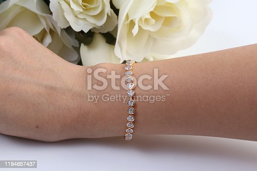Gold and diamond heart shape bracelet.