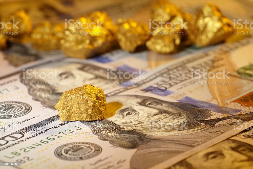 Gold and dollar bills stock photo