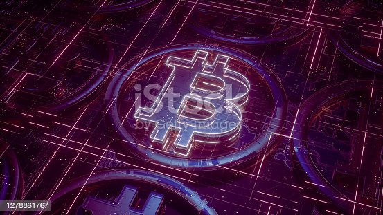 Gold and glass bitcoin sign on top of circuit board