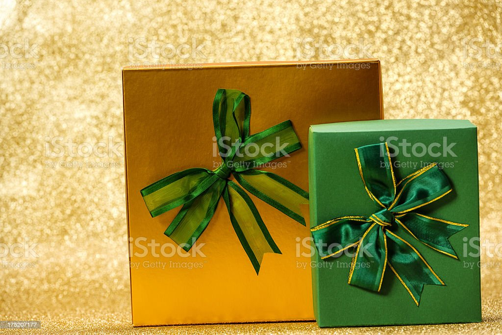 gold and green gifts royalty-free stock photo