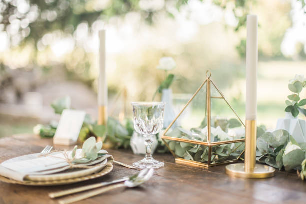 gold and pastel wedding dinning table decoration. geometic shapes, rustic decor, eucalyptus branches, candles, menu. bokeh background. - home decor boho imagens e fotografias de stock