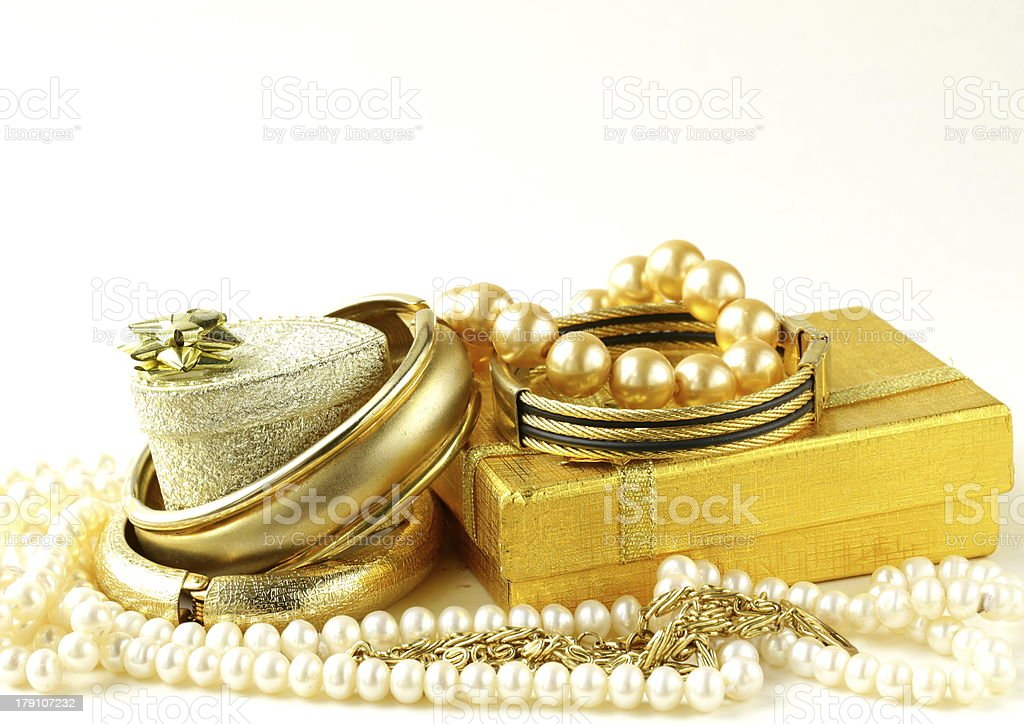 gold and pearl jewelry, gift boxes on a white background royalty-free stock photo