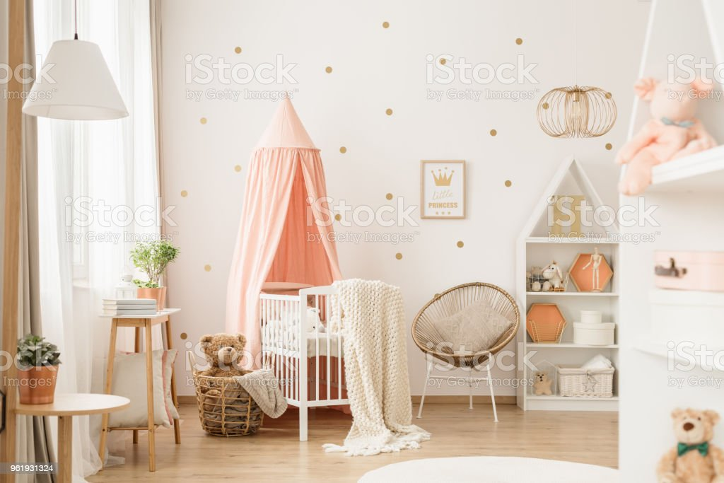 Gold and pink baby's bedroom stock photo