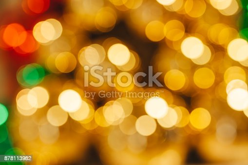 857847778 istock photo Gold and red shiny abstract blurred bokeh used for holiday or Christmas background. 878113982