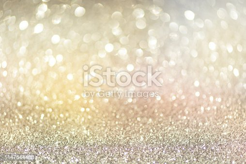 881350776 istock photo Gold and silver abstract bokeh lights. Shiny glitter background with copy space. New year and Christmas concept. Sparkling greeting card 1147544488