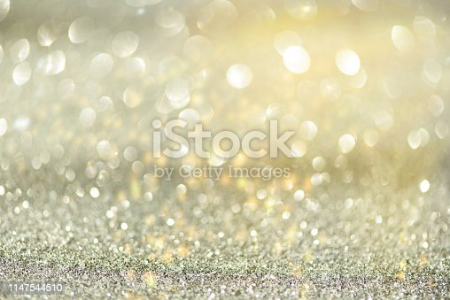881350776 istock photo Gold and silver abstract bokeh lights. Shiny glitter background with copy space. New year and Christmas concept. Sparkling greeting card 1147544510
