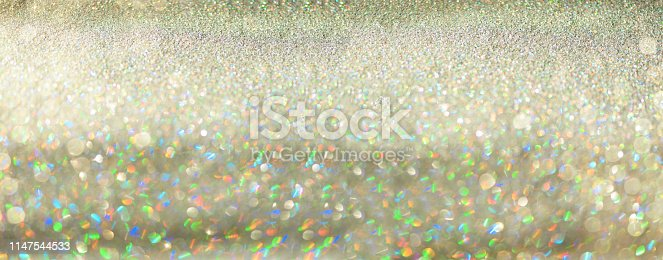 881350776 istock photo Gold and silver abstract bokeh lights. Shiny glitter background with copy space. New year and Christmas concept. Sparkling greeting card 1147544533
